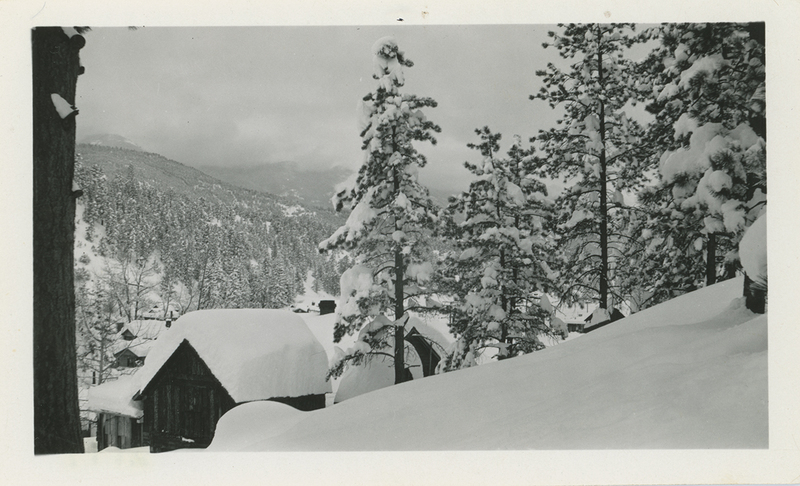 Wooden houses covered in snow at Bailey in 1933