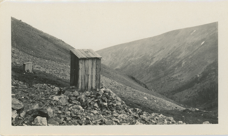 Small wooden structures on Broom of the Hills Mine at Buckskin Gulch