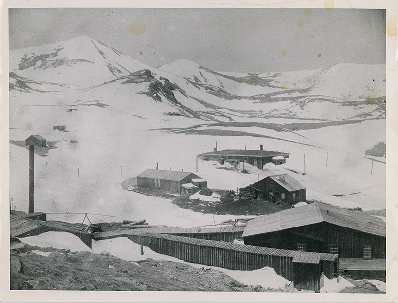 Wooden mining buildings in the snow at North London Mine