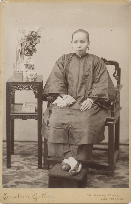 Woman of Asian descent sitting with bound feet