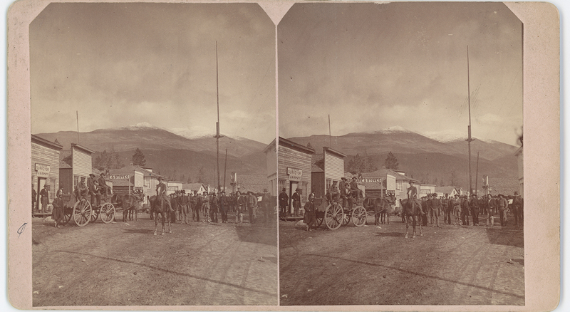Citizens standing in the town's dirt road at Alma, 1800s