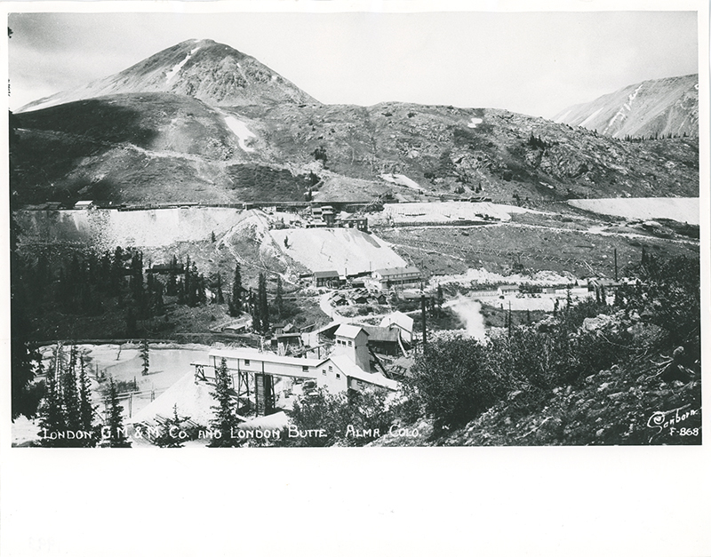 Postcard depicting a small mining town near London Mine