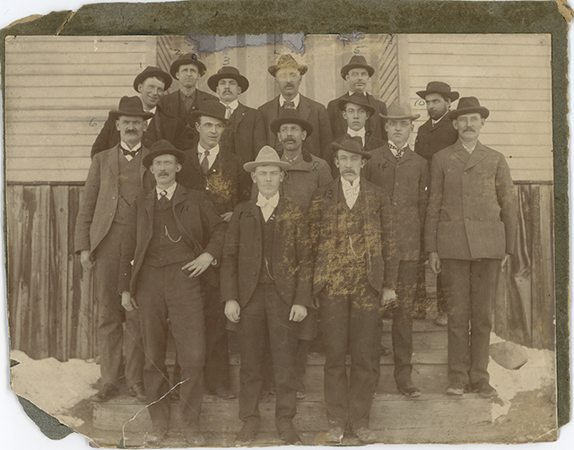 Mine crew from London Mine standing in a group for a photograph in 1896