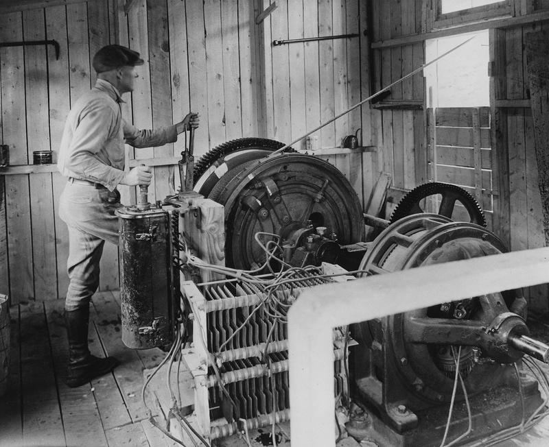 Man operating aerial tram 1930s